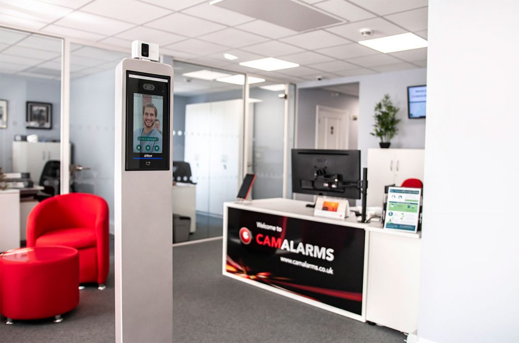 Location product photography for demonstration video of live thermal camera system in office reception area