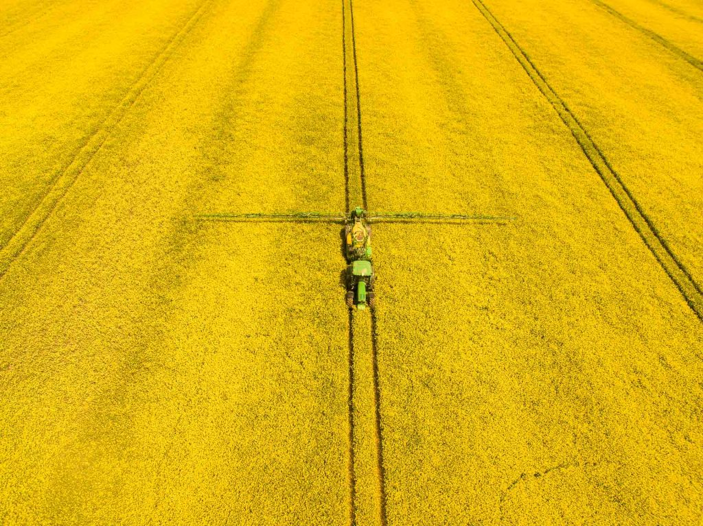 Aerial photograph of oil seed rape fields being sprayed